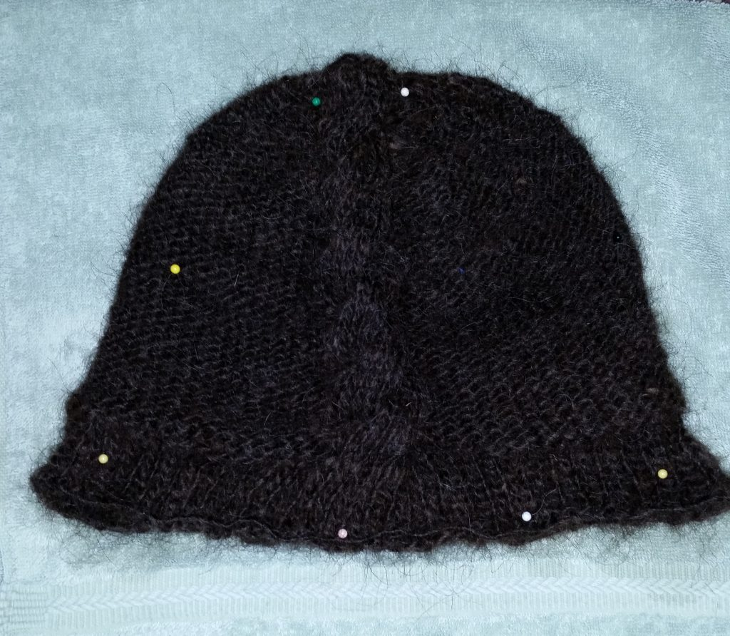 Brown hat with cable